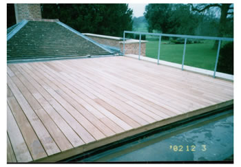 Wooden floor decking, Buntingford. Roof terrace with new wood decking..