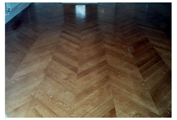 New parquet wood flooring, Chelsea, London. Oak parquet wood flooring in chevron pattern..