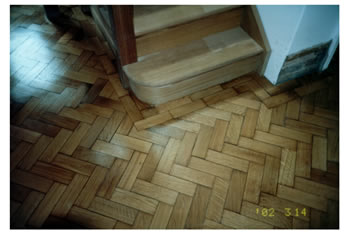 Wood floor repairs and stripping in Sevenoaks, Kent. We made repairs to this oak wood block floor with herringbone pattern..