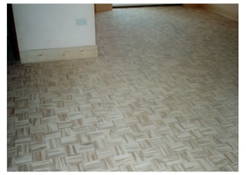 New wood flooring, St Albans, Herts.. Mosaic panels installed in a basket weave pattern and finished..
