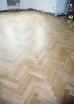 New parquet floor in Lambeth, London. We installed this new european oak parquet wood floor in a herringbone pattern with a two line border in mahogany.  .